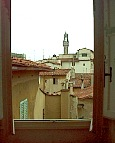 a view over the rooftops onto the Palazzo Veccio belltower from the window