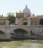 A view across the tiber river to St. Peter's and the Vatican